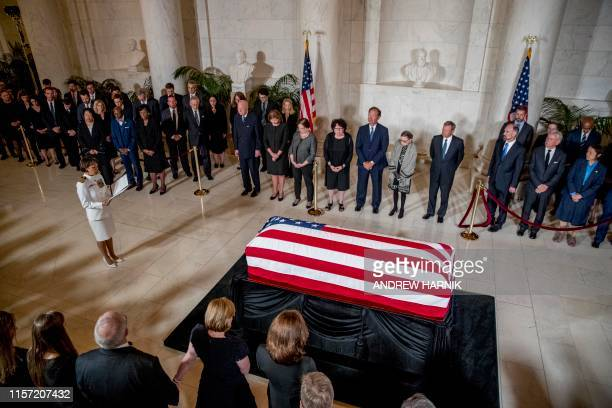 US Navy Chaplain Capt Judy Malana left accompanied by from center left retired Associate Justice Anthony Kennedy Ashley Kavanaugh the wife of...