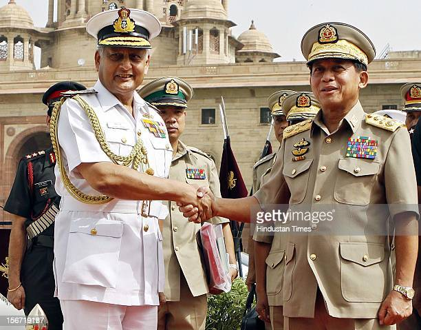 NEW DELHI INDIA AUGUST 3 Navy Chief and Chairman Chiefs of Staff Committee Admiral Nirmal Verma shakes hands with Mayanmar CommanderinChief of...