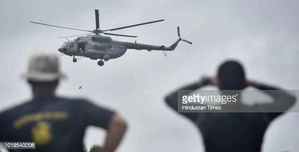 Navy choppers drop food for the people stranded at Pandanad in Chengannur Taluk on August 19 2018 in Alappuzha India The authorities have said that...