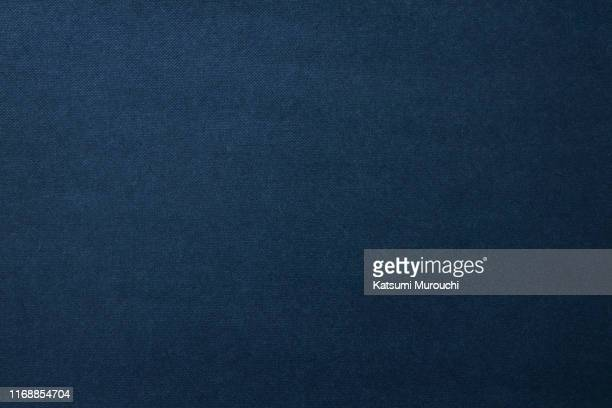 navy color spotted paper texture background - bleu photos et images de collection