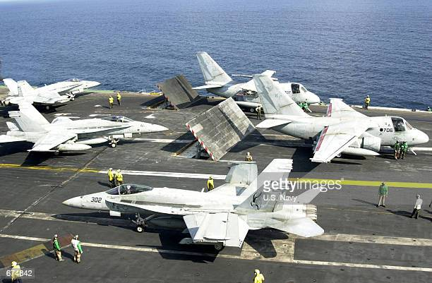 Navy combat aircraft line-up as the next launch cycle is set to begin November 26, 2001 aboard the USS Kitty Hawk. The USS Kitty Hawk is conducting...