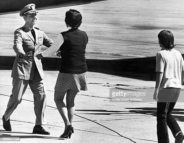 POW Navy Commander Robert Schwitzer is greeted by his wife and family after being released from North Vietnam Fairfield California March 18 1973