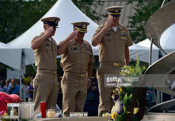 S Navy Commanding Officer Jefferey Jakubosky Executive Officer Blake Jacobson and Command Master Chief Steven Giordano salute after placing flowers...