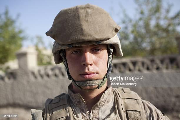 Navy Corpsman Arthur Mason 23 years from Phoenix Arizona patrols the partially deserted market August 13 2009 in Khan Neshin Afghanistan Corpsman...