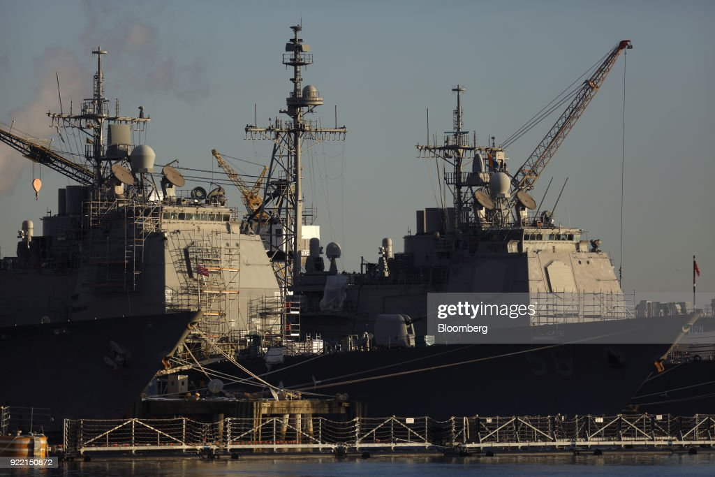U.S. Navy cruisers sit docked at the BAE Systems Plc Norfolk Ship Repair facility on the Elizabeth River in Norfolk, Virginia, U.S., on Tuesday, Jan. 9, 2018. BAE Systems Plc is scheduled to release earnings figures on February 22. Photographer: Luke Sharrett/Bloomberg via Getty Images