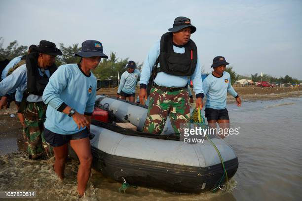 Navy divers prepare for day of searching the Lion Air flight 610 wreckage site on November 6 2018 in Karawang Indonesia Indonesian officials said...