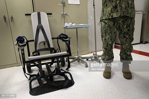 "Navy doctor displays a restraint chair in the detainee clinic in the ""Gitmo"" maximum security detention center on October 22, 2016 at the U.S. Naval..."