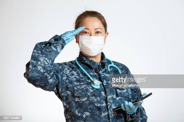 navy doctor or nurse saluting on a white background - saluting stock pictures, royalty-free photos & images