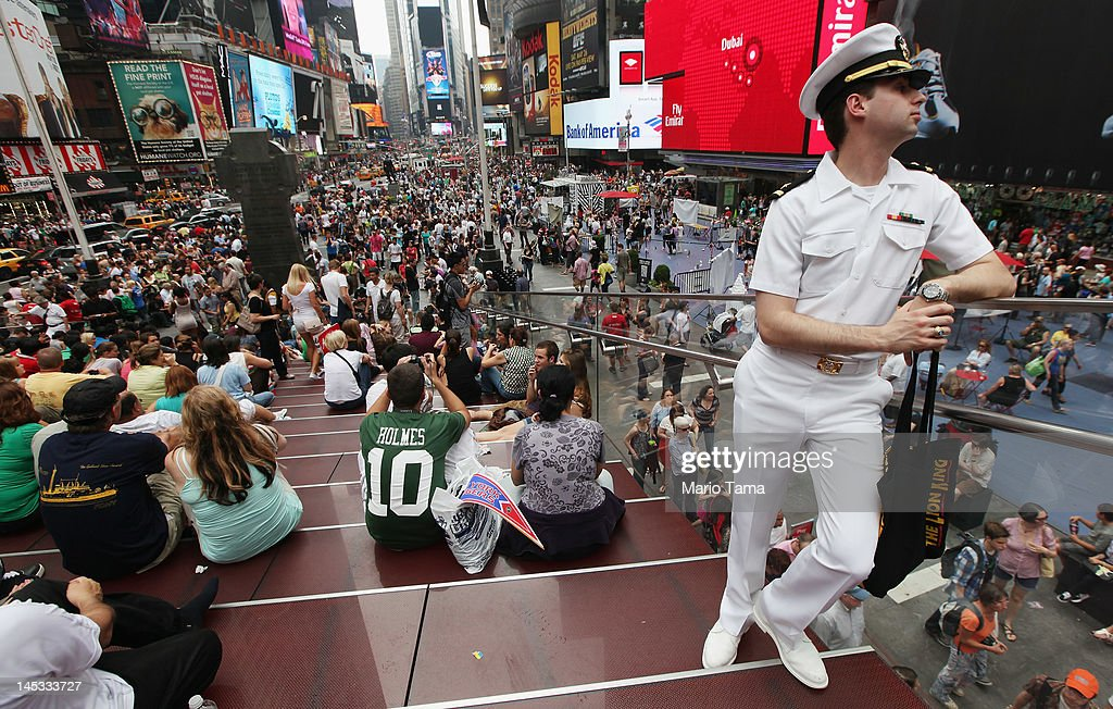 U.S. Navy Ensign Christopher Welty stands in Times Square during Fleet Week festivities on May 26, 2012 in New York City. Fleet week, which has been held in New York City since 1984, celebrates the U.S. Navy and Marines Corps with a week of ship visitations and military demonstrations. Fleet Week concludes on Memorial Day with a military flyover to honor those killed while serving in the military.