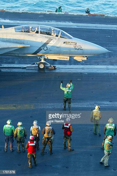 S Navy F14 is prepared to be launched off the deck December 26 2002 of the USS Constellation in the Persian Gulf The war planes from the aircraft...