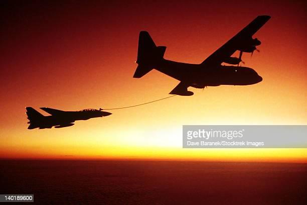 U.S. Navy F-14A Tomcat aerial refueling from a U.S. Marine Corps KC-130 Hercules.