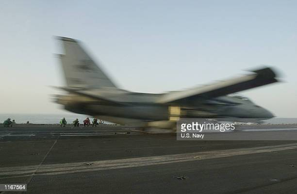 """Navy F-14D """"Tomcat"""" takes off from the flight deck of the USS Carl Vinson October 10, 2001 during military operations in the Arabian Sea."""