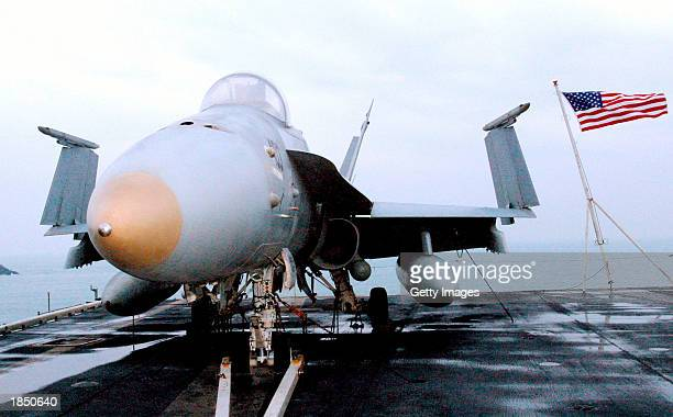 Navy F-18 fighter jet sits on the flight deck of aircraft carrier USS Carl Vinson after arriving at Pusan Port to participate in the joint U.S.-South...