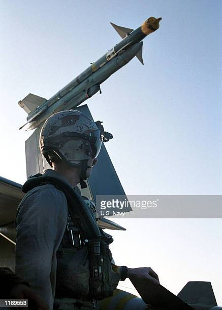 """Navy F/A-18 """"Hornet"""" pilot prepares for another strike mission October 16, 2001 aboard the USS Carl Vinson. The Vinson is conducting missions in..."""
