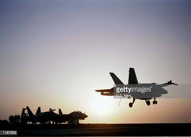 """Navy F/A-18 """"Hornet"""" prepares to land on the flight deck of the USS Carl Vinson October 11, 2001 during military operations in the Arabian Sea."""