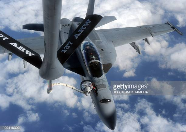 Navy FA18 Super Hornet connects to a KC135 air refuelling tanker during 'Keen Sword' USJapan military exercise above the South China sea on December...