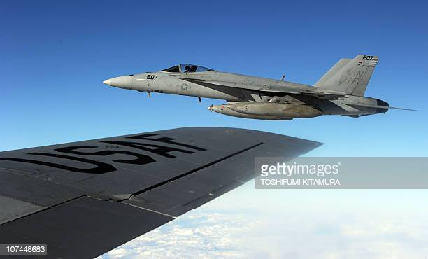 Navy FA18 Super Hornet is seen from a KC135 air refuelling tanker during 'Keen Sword' USJapan military exercise above the South China sea on December...