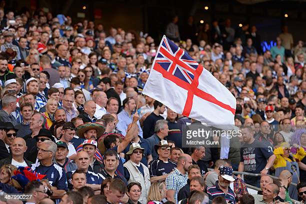 Navy fans wave an ensign during the Babcock Trophy rugby union match between The British Army and the Royal Navy played in Twickenham Stadium on May...