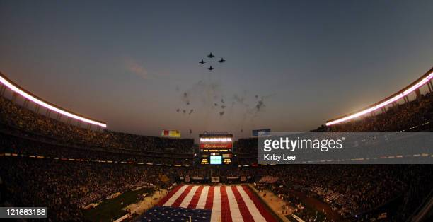 A Navy fighter plane flyover over Qualcomm Stadium during the national anthem at the Holiday Bowl in San Diego Calif on Thursday December 29 2005