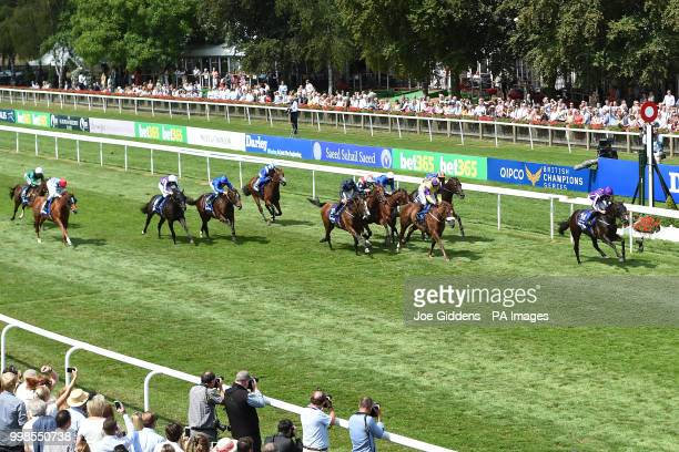 US Navy Flag ridden by Ryan Moore wins the Darley July Cup Stakes during day three of The Moet Chandon July Festival at Newmarket Racecourse