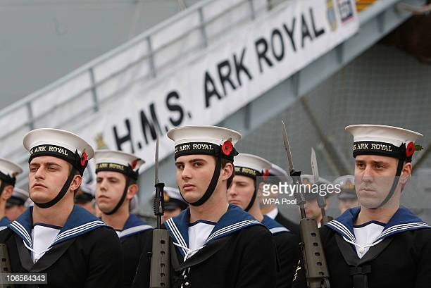 A navy guard of honour on parade on the quayside where HMS Ark Royal is moored on November 5 2010 in Portsmouth United Kingdom Queen Elizabeth II...