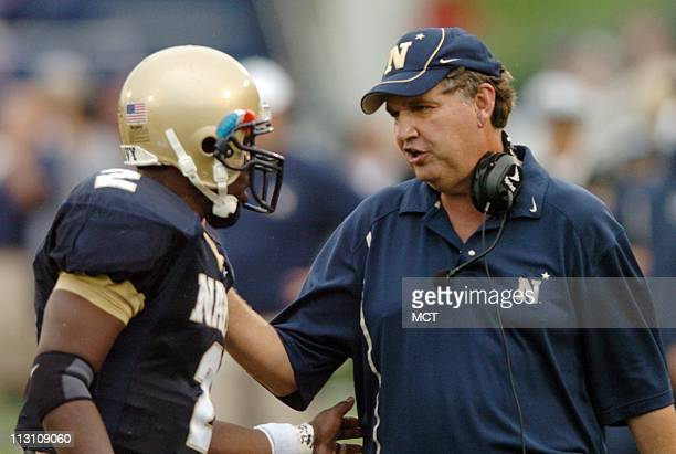 ANNAPOLIS MD Navy head coach Paul Johnson talks with quarterback Lamar Owens in the third quarter against Air Force on Saturday October 8 2005