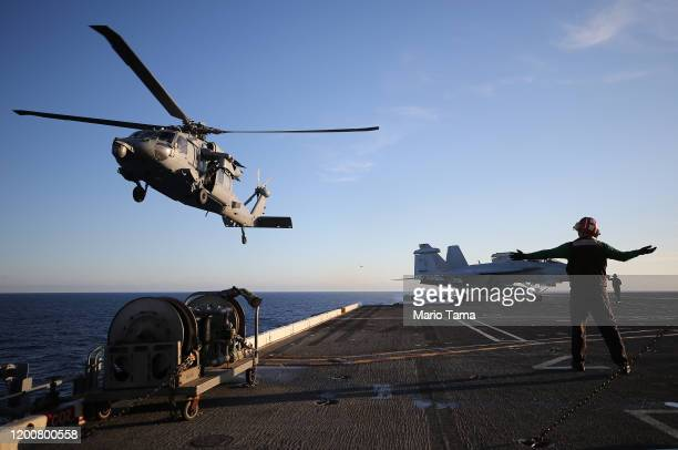 S Navy helicopter descends to land on the flight deck of the USS Nimitz aircraft carrier while at sea on January 18 2020 off the coast of Baja...
