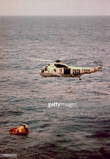 US Navy helicopter prepare the Apollo 8 Command module for hoisting aboard the USS Yorktown in the Pacific northwest of the Hawaiian Islands 27...