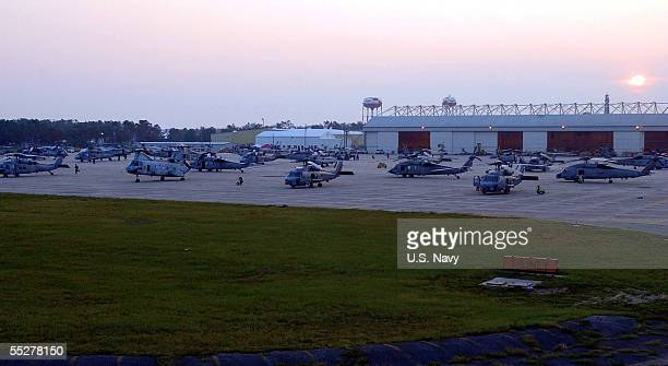 Navy helicopters are prepared for a day of search and rescue operations for victims of Hurricane Katrina at the Naval Air Station September 5, 2005...
