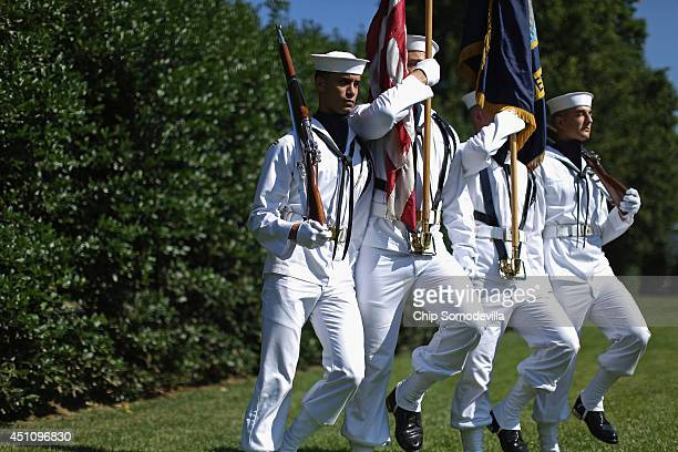 Navy honor guard arrives for an award ceremony to honor the victims and recognize the heroic actions of the people involved in the Washington Navy...