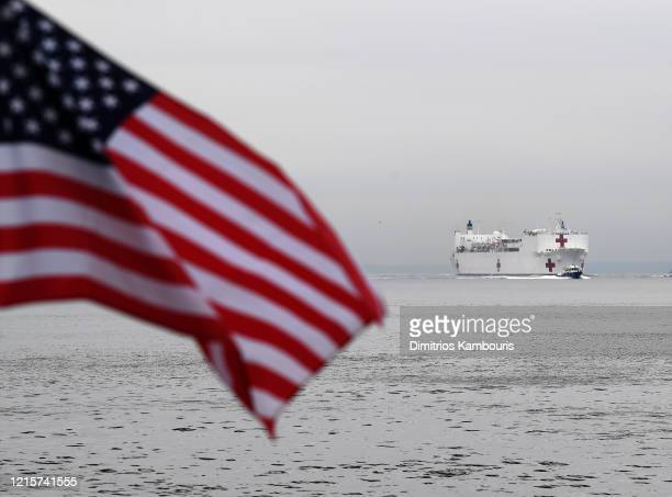Navy Hospital Ship USNS Comfort travels heads to Pier 90 as the coronavirus pandemic continues to overwhelm medical infrastructure on March 30 2020...