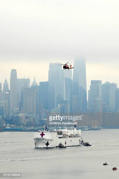 Navy Hospital Ship USNS Comfort travels up the Hudson River as it heads to Pier 90 as the coronavirus pandemic continues to overwhelm medical...