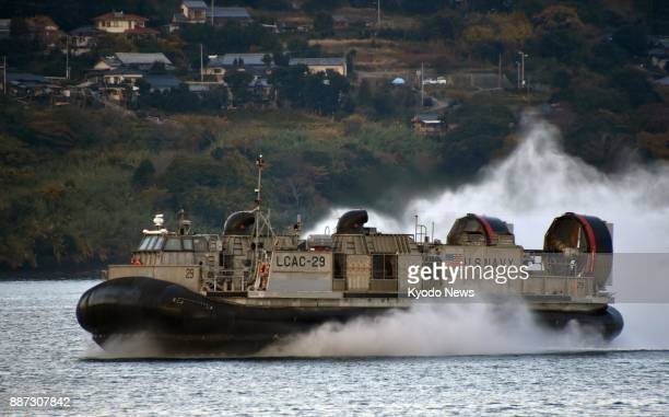 A US Navy hovercraft known as Landing Craft Air Cushion takes part in a nighttime exercise in waters off Saikai Nagasaki Prefecture in southwestern...