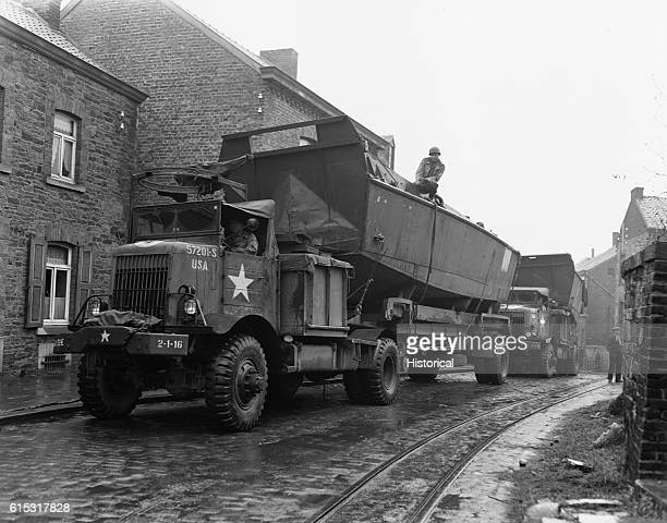 VehiclePersonnel roll up the street of a Belgian village enroute to cross the Rhine
