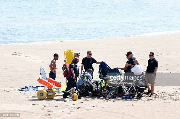 A Navy Leap Frog parachuter receives medical attention on North Avenue Beach on Aug 15 after a performance at the first day of the annual Chicago Air...