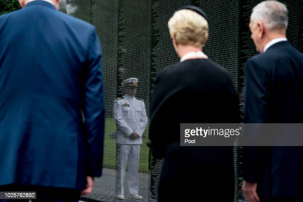 Navy Lt Jack McCain the son of Sen John McCain RAriz is reflected in the wall of the Vietnam Memorial as Jack's mother Cindy McCain accompanied by...