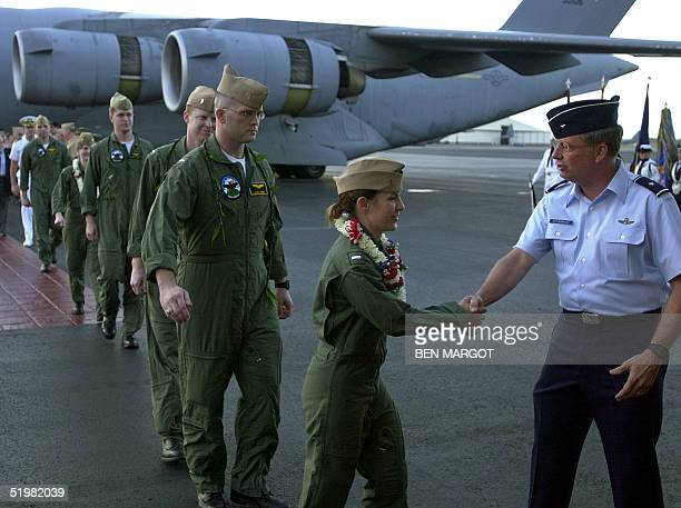 Navy Lt Regina Kauffman of Warminster PA one of the 24 crewmembers of the US reconnaisance plane detained in China is greeted by an unidentified Air...