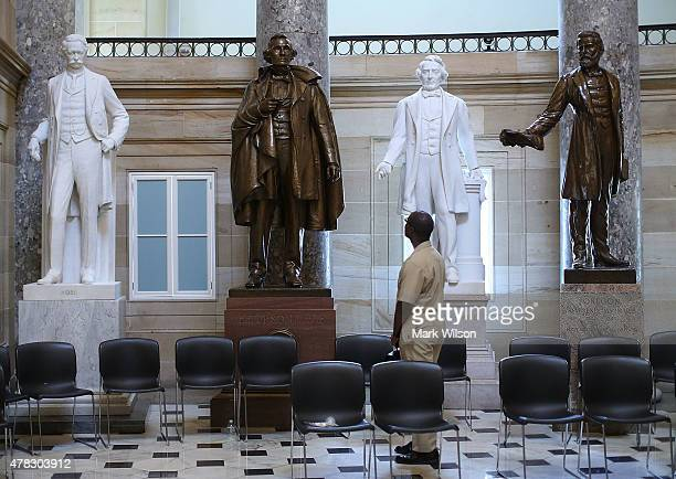Navy Lt William Edmund Newsome looks at a bronze statue of Confederate president Jefferson Davis that stands inside of Statuary Hall at the US...