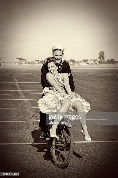 wwii navy man and his pretty woman riding a bike - world war ii stock pictures, royalty-free photos & images