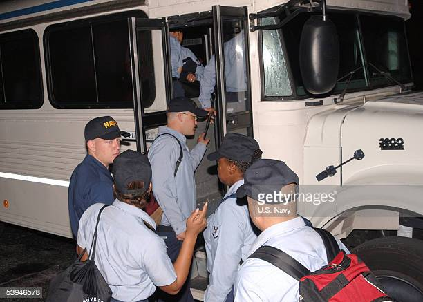 S Navy medical personnel board buses at the Naval Air Station September 1 2005 in Jacksonville Florida The sailors will travel to Pensacola where...