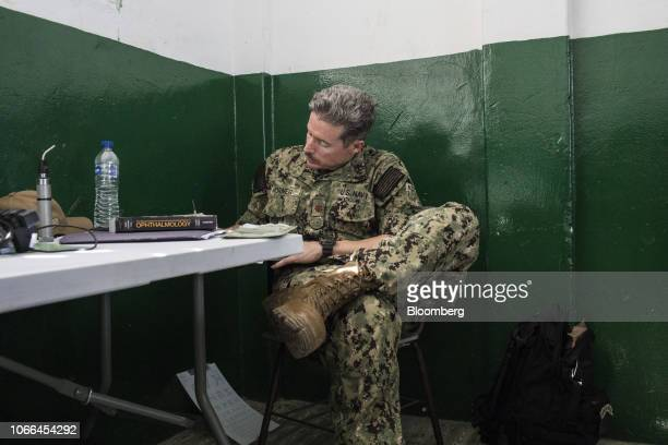 A US Navy medical staff member fills out paperwork at a converted medical site in Riohacha Colombia on Tuesday Nov 27 2018 Hundreds of Venezuelans...