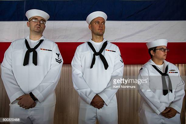 S Navy members stand during a memorial service marking the 74th Anniversary of the attack on the US naval base at Pearl Harbor December 07 2015 on...