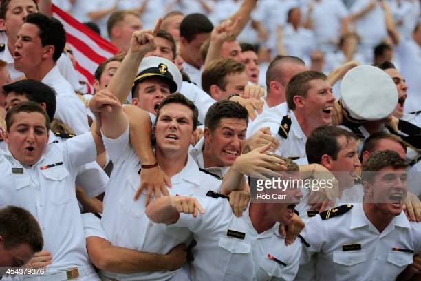 Navy Midshipmen cheer after the Midshipmen scored a touchdown against the Ohio State Buckeyes during the first half at MT Bank Stadium on August 30...