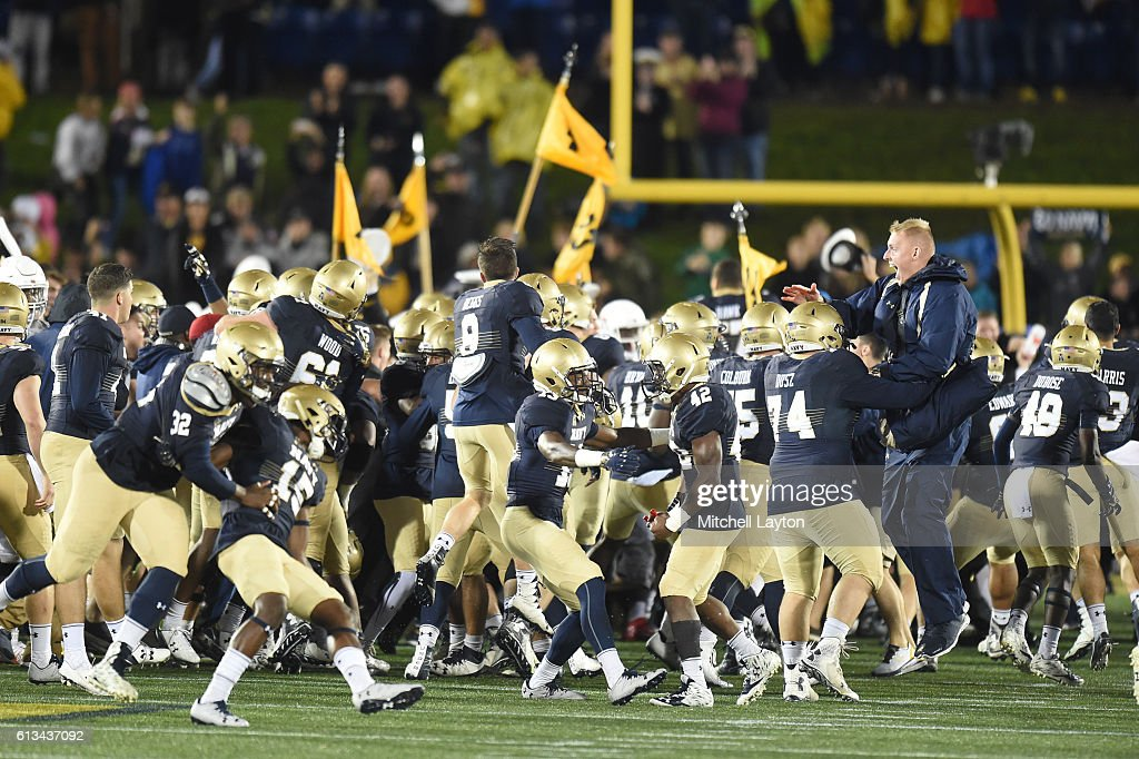 Navy Midshipmen fans run on the field after a football game against the Houston Cougars at Navy-Marines Memorial Stadium on October 8, 2016 in Annapolis, Maryland. The Midshipman won 46-40.