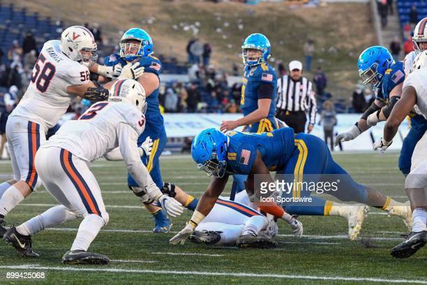 Navy Midshipmen fullback Chris High is brought down at the 2 yard line in the fourth quarter by Virginia Cavaliers linebacker Zane Zandier on...