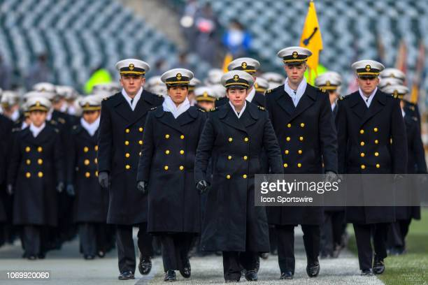 Navy Midshipmen march on to the field before the football game between the Army Black Knights and the Navy Midshipmen on December 08 2018 at Lincoln...