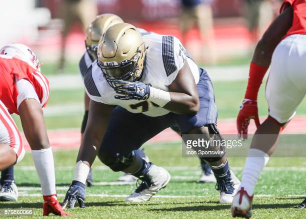 Navy Midshipmen offensive guard Laurent Njiki sets up at the line of scrimmage during the football game between the Navy Midshipmen and Houston...