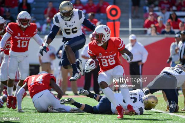 Navy Midshipmen outside linebacker Myles Davenport hurdles players in an attempt to tackle Houston Cougars wide receiver John Leday during a kickoff...