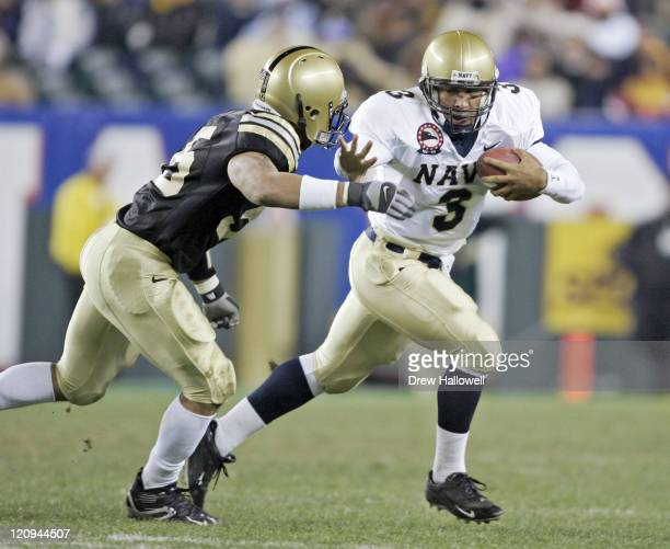 Navy Midshipmen quarterback Brian Hampton pushes off Army Cadet line backer Barrett Scruggs Dec 3 2005 at Lincoln Financial Field in Philadelphia...