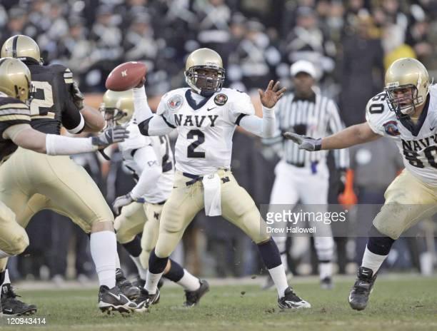 Navy Midshipmen quarterback Lamar Owens looks for an open receiver Saturday December 3 2005 at Lincoln Financial Field in Philadelphia PA